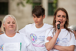London, UK. 30 May, 2019. Poppy Rose (r), co-founder of SEND National Crisis, seen here with colleague Sharon Pratt (l), addresses fellow campaigners attending a demonstration in Parliament Square to demand improvements in the diagnosis and assessment of young people with SEND, assistance for their families, funding and legal and financial accountability for local authorities in their treatment of young people with SEND and their families. Credit: Mark Kerrison/Alamy Live News