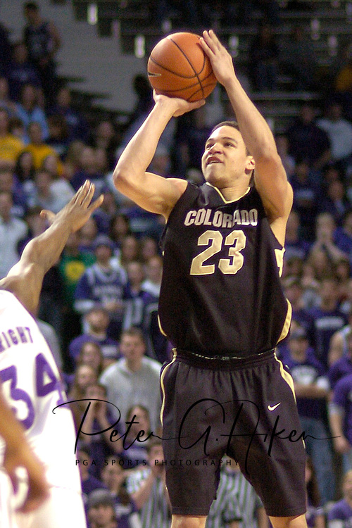 Colorado guard Richard Roby (R) hits a three pointer over Kansas State's Akeem Wright (L) during the first half of the Wildcats 72-60 win over the Buffaloes at Bramalage Coliseum in Manhattan, Kansas, February 18, 2006.
