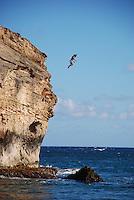 Hawaii, Shipwreck Beach - man cliff-jumping
