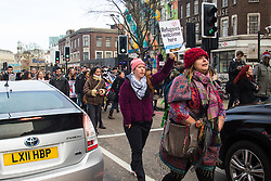 "St Pancras, London, January 16th 2016. Dozens of protesters hold an ""emergency demonstration and die-in"" as France prepares to bulldoze the Jungle Camp at Calais. PICTURED: Protesters march through the traffic on the Euston Road. ///FOR LICENCING CONTACT: paul@pauldaveycreative.co.uk TEL:+44 (0) 7966 016 296 or +44 (0) 20 8969 6875. ©2016 Paul R Davey. All rights reserved."