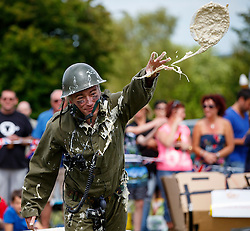 © Licensed to London News Pictures. 06/06/2015. Kent, UK. World Custard Pie Championships takes place at Coxheath Village Hall in Kent on Saturday, 6 June 2015. During the annual event competitors throw custard pies to each other in teams of four and they are judged by their strikes on other competing teams. Photo credit: Tolga Akmen/LNP