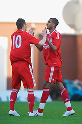 WARRINGTON, ENGLAND - Wednesday, April 29, 2009: Liverpool's David Ngog celebrates scoring the second goal against Newcastle United with team-mate Andras Simon during the FA Premiership Reserves League (Northern Division) match at the Halliwell Jones Stadium. (Photo by David Rawcliffe/Propaganda)
