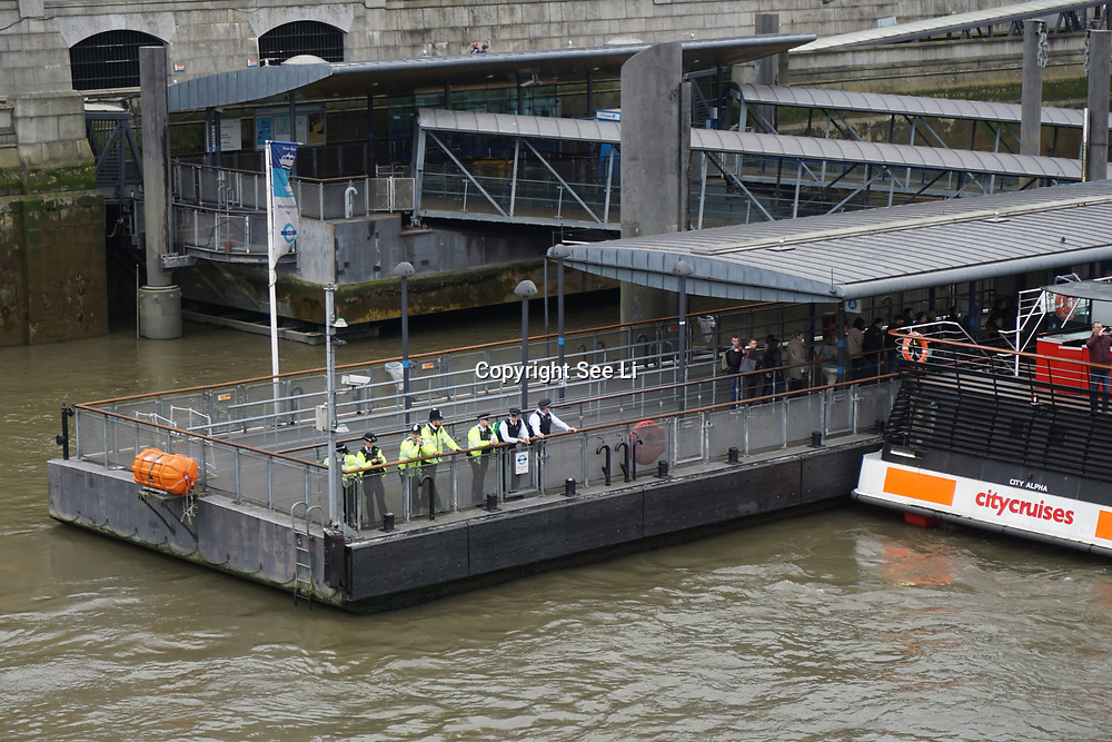 London,England,UK: 29th March 2017. Police, ambulance and fire brigade crews looking for the person jump into the river thames witness by a ladies at Westminster bridge. by See Li