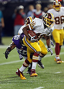 Washington Redskins running back Alfred Morris (46) runs for a first down with goal to go in the second quarter while dodging a diving tackle attempt by Minnesota Vikings middle linebacker Erin Henderson (50) during the NFL week 10 football game against the Minnesota Vikings on Thursday, Nov. 7, 2013 in Minneapolis. The Vikings won the game 34-27. ©Paul Anthony Spinelli