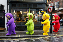 © Licensed to London News Pictures. 20/11/2016. London, UK. Performers dressed as Teletubbies make their way to Regent Street as over 400 cast members get ready to participate in Hamley's Toy Parade, which marches along Regent Street in London in a colourful extravaganza, with marching bands, dancers and toy vehicles. Photo credit: Tolga Akmen/LNP