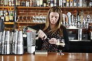 "SHOT 3/25/14 2:58:19 PM - Euclid Hall bar manager Jessica Cann of Denver, Co. prepares a ""Return of the Naughty Girl Scout"", a beer cocktail that mixes chocolate liquer, coffee liqueur, peppermint schnapps, and Left Hand Nitro Milk Stout beer $11. (Photo by Marc Piscotty / © 2014)"