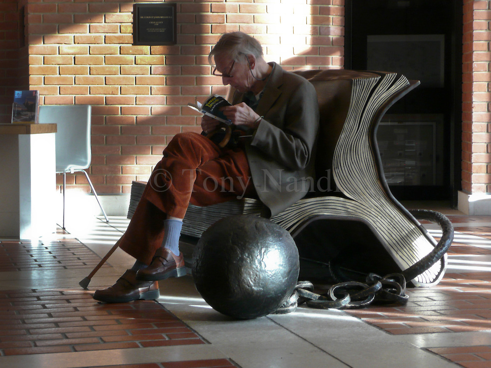 A reader on a sculpture in the British Library, London