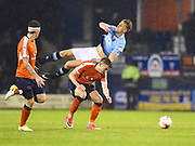 Blackpool player Mark Cullen is up ended during the second half during the EFL Sky Bet League 2 play off second leg match between Luton Town and Blackpool at Kenilworth Road, Luton, England on 18 May 2017. Photo by Ian  Muir.