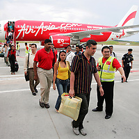 Passengers walk out from Air Asia carrier at low cost terminal, Sepang ,Malaysia