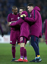 Manchester City's Fernandinho (left), Bernardo Silva (centre) and Ederson celebrate after the Emirates FA Cup, Fourth Round match at Cardiff City Stadium.