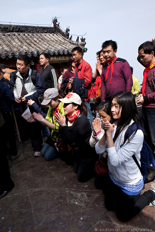 Asia, China, Hubei province.  Chinese pilgrims praying at the Golden Palace on the Heavenly Pillar Peak of Wudang moutain (Wudang-san), a World Heritage mountain with many Taoist monasteries.