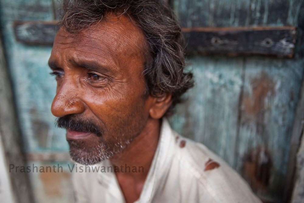 45 year old Nathhu Goswal sits outside his home in Seelaum in Chattarpur Madhya Pradesh, India, on Tuesday September 8, 2009.  Nathhus brother and family have left the village. He survives taking loans and having one meal a day. Photographer: Prashanth Vishwanathan/Action Aid