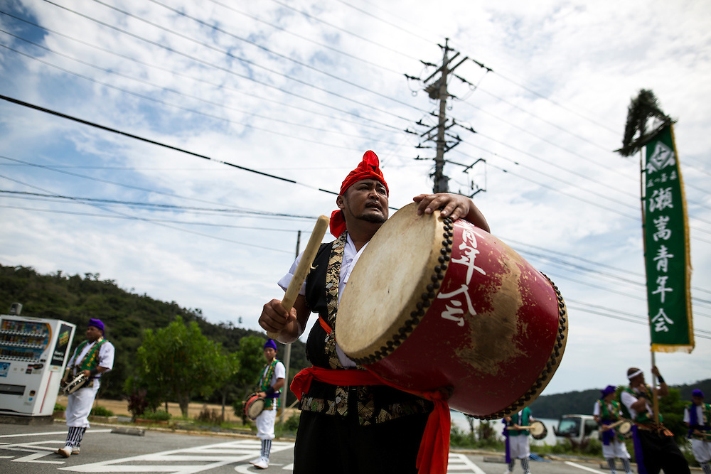 OKINAWA, JAPAN - AUGUST 17 : Local Eisa folk dancers perform a modern Eisa folk dance in a small village in Nago during the Obon festival to honour the spirits of their ancestors on August 17, 2016, Okinawa prefecture, Japan.  (Photo by Richard Atrero de Guzman/NURPhoto)