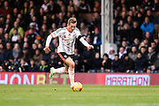 George Williams during the Sky Bet Championship match between Fulham and Huddersfield Town at Craven Cottage, London, England on 8 November 2014.