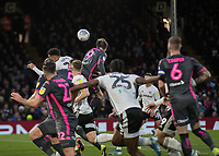 Football - 2019 / 2020 Sky Bet (EFL) Championship - Fulham vs. Leeds United<br /> <br /> Patrick Bamford (Leeds United) rises highest in a melee of players attacking the ball at Craven Cottage<br /> <br /> COLORSPORT/DANIEL BEARHAM
