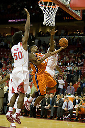 Virginia guard Sean Singletary (44) shoots against Maryland forward Bambale Osby (50).  The Maryland Terrapins defeated the Virginia Cavaliers men's basketball team 85-75 at the Comcast Arena in College Park, MD on January 30, 2008.