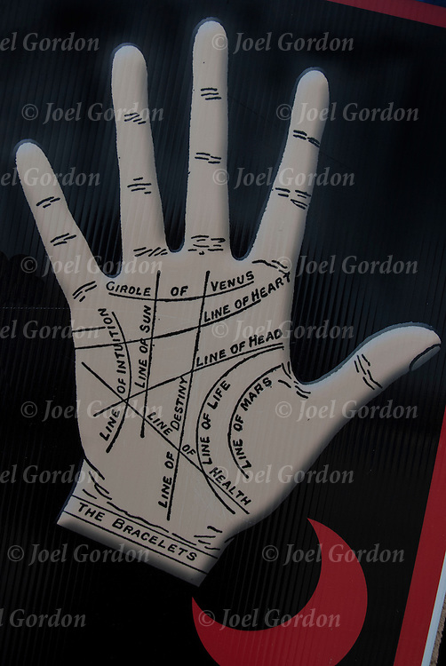 Palmistry or palm reading in sign on boardwalk in Atlantic City, NJ.<br /> <br /> Telling fortunes by lines on the palm of the hand, foretelling a person's future and reveal their past through an analysis of the lines on a person's hand.