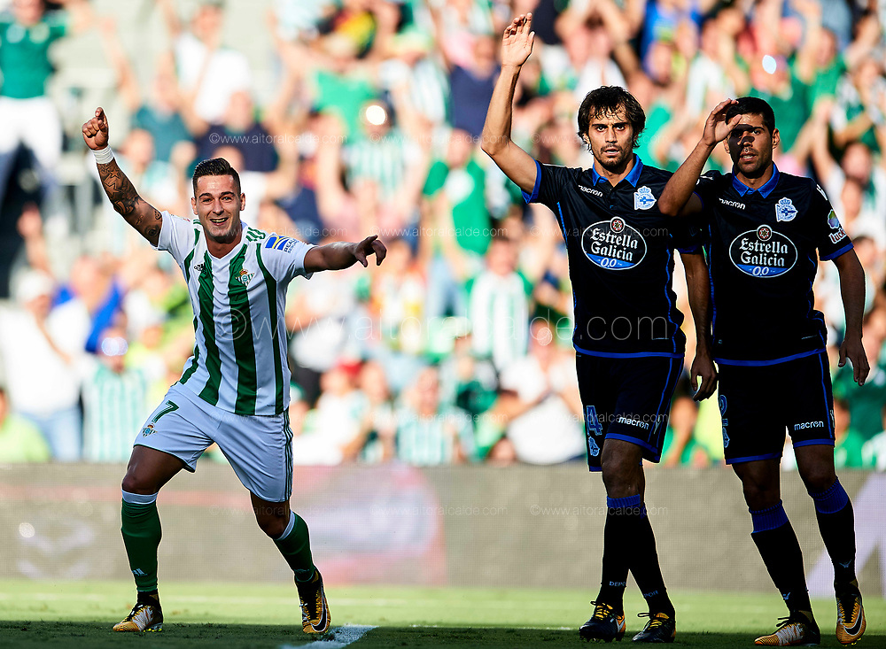 SEVILLE, SPAIN - SEPTEMBER 16:  Sergio Leon of Real Betis Balompie celebrates after scoring his team mate Joaquin Sanchez of Real Betis Balompie during the La Liga match between Real Betis and Deportivo La Coruna  at Estadio Benito Villamarin on September 16, 2017 in Seville, .  (Photo by Aitor Alcalde Colomer/Getty Images)