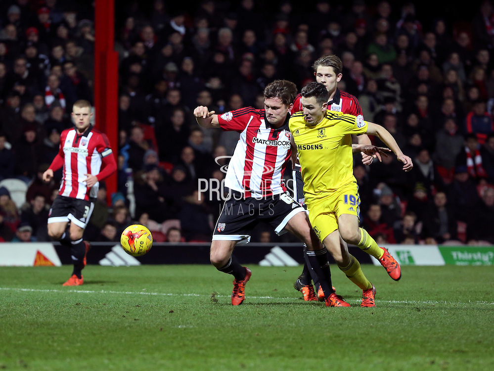 Middlesbrough midfielder Stuart Downing battling with Brentford defender Harlee Dean during the Sky Bet Championship match between Brentford and Middlesbrough at Griffin Park, London, England on 12 January 2016. Photo by Matthew Redman.