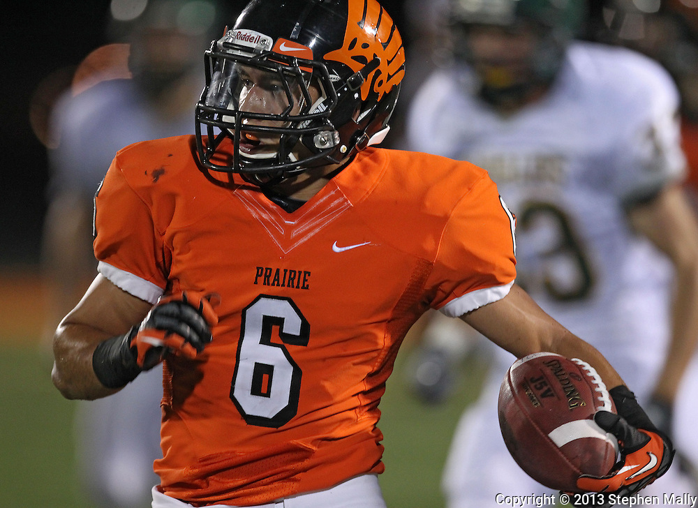 Prairie's Jesse Vizzini (6) returns a kickoff during their game at John Wall Memorial Stadium at Prairie High School in Cedar Rapids on Friday, September 6, 2013.