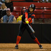 02 March 2018: San Diego State softball closes out day two of the San Diego Classic I at Aztec Softball Stadium with a night cap against CSU Northridge. San Diego State first baseman Taylor Stewart (21) hits a long fly out to left field for the first out of the bottom of the seventh inning. The Aztecs dropped a close game 2-0 to the Matadors. <br /> More game action at sdsuaztecphotos.com