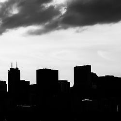 Chicago skyline silhouette panorama photo in black and white. Panorama photo ratio is 1:3. Picture includes Willis Tower (Sears Tower) and many other downtown Chicago buidlings. Image Copyright © 2010 Paul Velgos with All Rights Reserved.