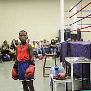 Oratile Mohlakoang is getting ready for his boxing match during an amateur boxing tournament in Cosmo City, a large housing development conceived for low-income households northwest of Johannesburg city centre.