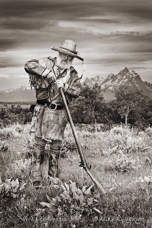 Mountain Man in the Grand Teton valley, setting traps and hunting along the streams and creeks. Filling his flintlock rifle with gun powder.