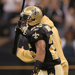 16 January 2010:  New Orleans Saints running back Reggie Bush (25) runs on to the field with a bat prior to kickoff of a 45-14 win by the New Orleans Saints over the Arizona Cardinals in a 2010 NFC Divisional Playoff game at the Louisiana Superdome in New Orleans, Louisiana.
