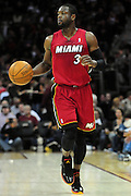 March 29, 2010; Cleveland, OH, USA; Miami Heat shooting guard Dwyane Wade (3) makes his way down court during the third quarter against the Cleveland Cavaliers at Quicken Loans Arena. The Cavaliers beat the Heat 102-90. Mandatory Credit: Jason Miller-US PRESSWIRE