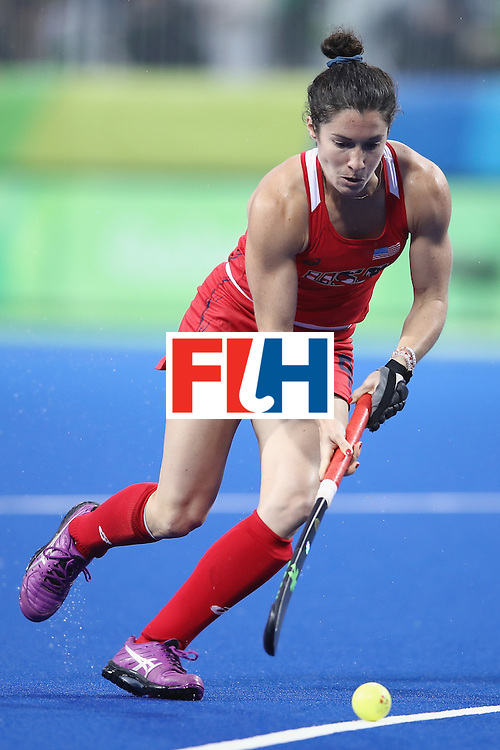RIO DE JANEIRO, BRAZIL - AUGUST 10:  Michelle Vittese of the United States runs the ball forward during the women's pool B match between the United States and Japan on Day 5 of the Rio 2016 Olympic Games at the Olympic Hockey Centre on August 10, 2016 in Rio de Janeiro, Brazil.  (Photo by Mark Kolbe/Getty Images)