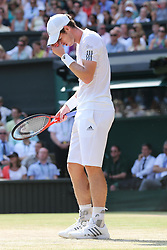Andy Murray in action against Novak Djokovic in the  Men's Final at the Wimbledon Tennis Championships in  London, Sunday, 7th July 2013<br /> Picture by Stephen Lock / i-Images