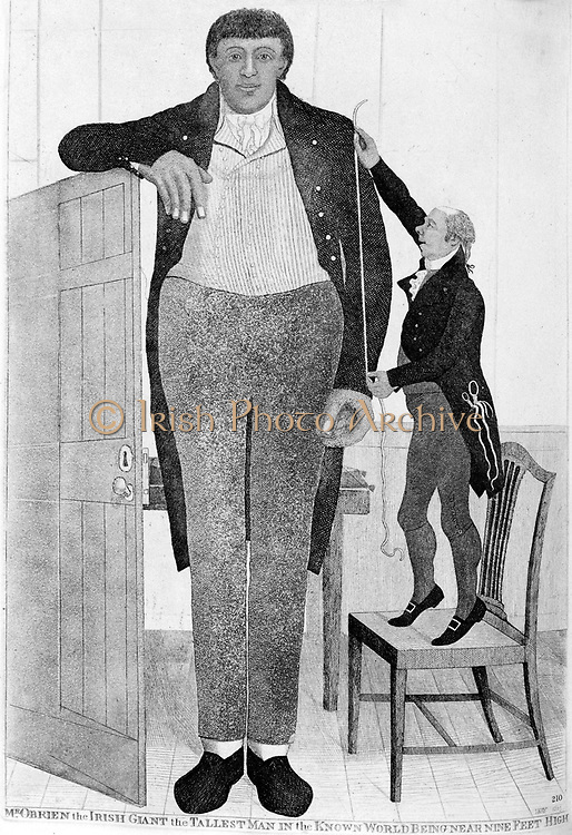 Mr O'Brien, the Irish Giant, the Tallest Man in the Known World', 1803. Patrick O'Brien (c1765-1804), the Irish giant, being measured for a suit by an Edinburgh tailor. O'Brien was 8 feet 7 inches (2.616m) tall. Such abnormal growth manifested by those suffering from Gigantism is caused by an over-active pituitary gland (endocrine system) producing an excess of growth hormone. Etching by John Kay.