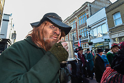 "© Licensed to London News Pictures. 08/12/2019. ROCHESTER, UK. A man dressed as Fagin from ""Oliver Twist"" takes part in the annual Dickensian Christmas Festival in Rochester.  The Kent town is given a Victorian makeover to celebrate the life of the writer Charles Dickens (who spent much of his life there), with Victorian themed street entertainment, costumed parades and a Christmas market.  Photo credit: Stephen Chung/LNP"