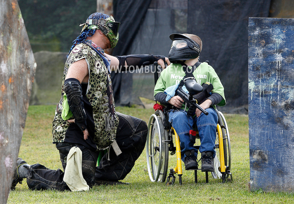 Ed Dykshoorn Jr., left, of the War Hounds paintball team talks to Evan Sugrue, 11, of Monsey, before Evan and other members of the New Life Van Paintball League played at the Montgomery Sporting Goods paintball fields in the Town of Wallkill on Saturday, Sept. 21, 2013.