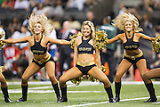NEW ORLEANS, LA - SEPTEMBER 20:  Cheerleaders of the New Orleans Saints perform during a game against the Tampa Bay Buccaneers at Mercedes-Benz Superdome on September 20, 2015 in New Orleans Louisiana.  The Buccaneers defeated the Saints 26-19.  (Photo by Wesley Hitt/Getty Images) *** Local Caption ***