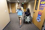 Riley Ljungdahl makes her way to class with her friend Amanda Ward, Thursday, May 2, 2013, at St. John the Baptist School in Longmont. (Matthew Jonas/Times-Call)