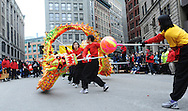 February 13, 2011 - Members of the Gund Kwok Asian Women Lion & Dragon Dance Troupe perform the traditional Dragon Dance during New Year celebrations in Boston's China Town.