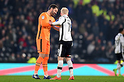 Derby County goalkeeper Scott Carson (1) helps Derby County forward Will Hughes (19) after a foul during the EFL Sky Bet Championship match between Derby County and Bristol City at the Pride Park, Derby, England on 11 February 2017. Photo by Jon Hobley.