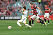 20.10.2013 Sydney, Australia. Wellingtons defender Reece Caira in action during the Hyundai A League game between Western Sydney Wanderers FC and Wellington Phoenix FC from the Pirtek Stadium, Parramatta. The game ended in a 1-1 draw.