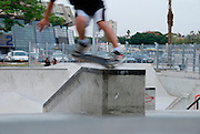 Israel, Tel Aviv, Yad Eliyahu, Urban extreme sport park. Young male performing stunts with a skateboard