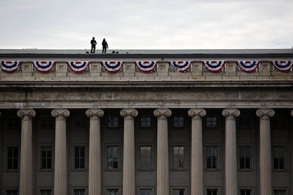 Security stands watch on the roof of the Department of the Treasury before the inauguration inauguration parade for Pres. Barack Obama on January 21, 2013 in Washington, D.C.