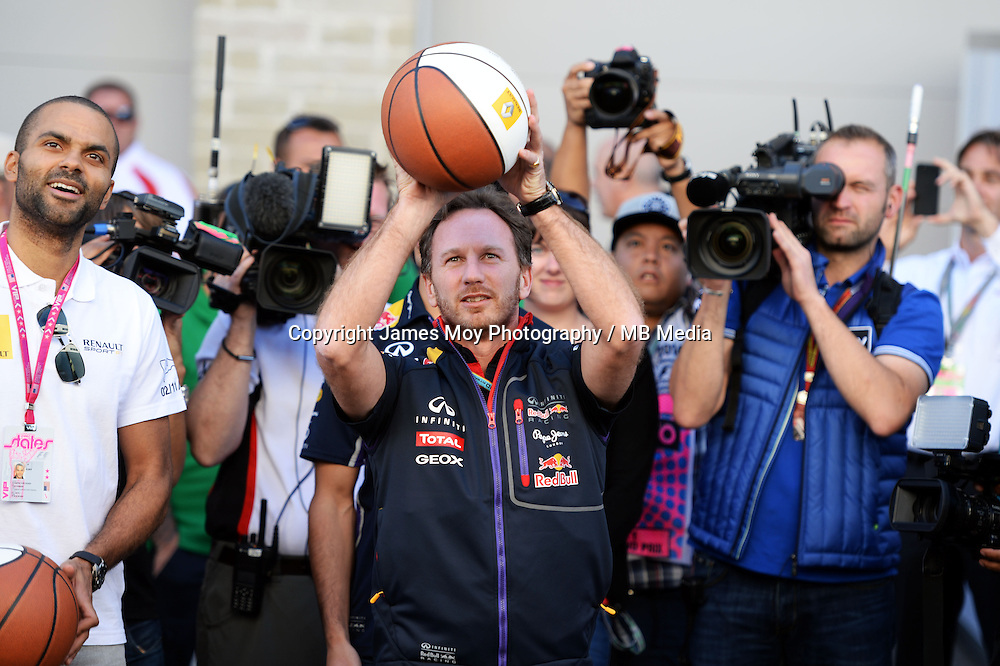 Christian Horner (GBR) Red Bull Racing Team Principal practices his basketball skills with Tony Parker (FRA) NBA Basketball Player (Left).<br /> United States Grand Prix, Saturday 1st November 2014. Circuit of the Americas, Austin, Texas, USA.