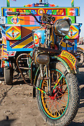 Colorful motorbike with cart on harbor dock (India)