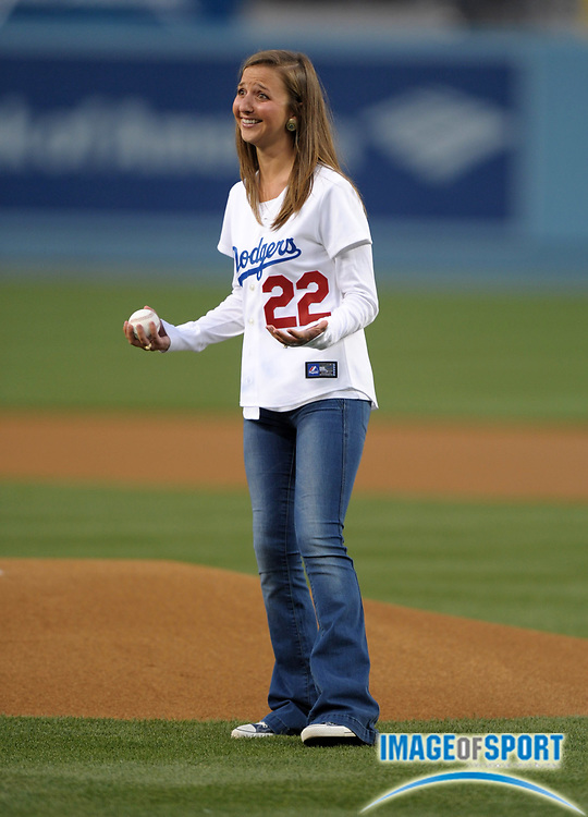 Apr 11, 2012; Los Angeles, CA, USA; Ellen Kershaw throws out the first pitch before the MLB game between the Pittsburgh Pirates and the Los Angeles Dodgers at Dodger Stadium. Ellen is the wife of Los Angeles Dodgers pitcher Clayton Kershaw (not pictured).