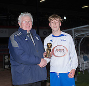Reece Lornie of Grove Academy receives the man of the match award from Dave Forbes of Sponsors Dundee FC Supporters Society after his side had beaten St Johns in the Under 15s Senior Sports Cup Final at Dens Park<br /> <br /> <br />  - &copy; David Young - www.davidyoungphoto.co.uk - email: davidyoungphoto@gmail.com