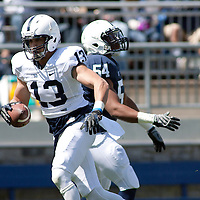 Penn State wide receiver Tyler Lucas #13 catches a pass in front of linebacker Titus Morris #54 during warm ups before the annual Blue/White game on April 20, 2013 at Beaver Stadium in University Park, Pa.