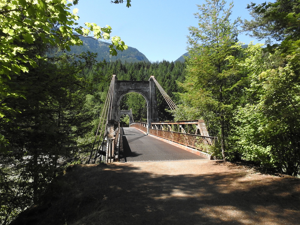 The Alexandria Bridge is a steel arch-span bridge crossing the Fraser River near Spuzzum, British Columbia, along the Trans-Canadian Highway. The last auto crossed in 1964. The bridge is used as foot access to the Alexandria Bridge Provincial Park. Photo by Alan Cradick.