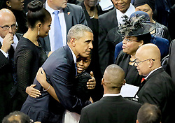 President Barack Obama hugs members of Pinckney family Friday, June 26, 2015, in Charleston. President Barack Obama will deliver the eulogy for one of the victims, Sen. Clementa Pinckney, during his funeral Friday at TD Arena . (Paul Zoeller/The Post and Courier)