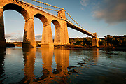Menai Suspension Bridge (Welsh: Pont Grog y Borth) is a stone built Victorian suspension bridge between the island of Anglesey and Bangor and mainland of Wales. The 100ft high bridge was designed by Thomas Telford and completed in 1826.